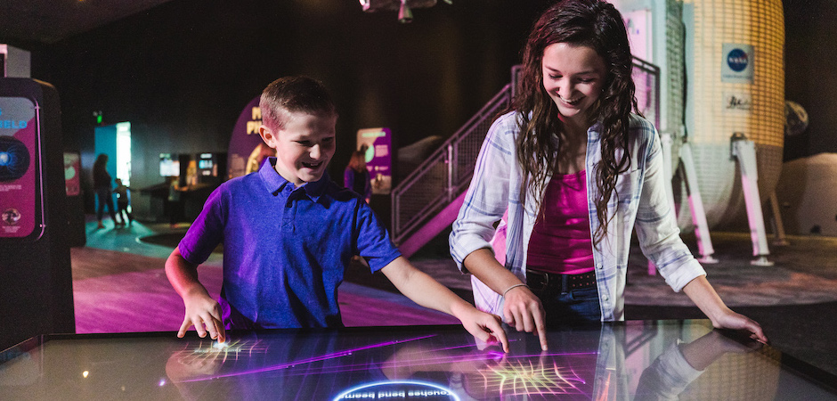Family using touch screen exhibit.