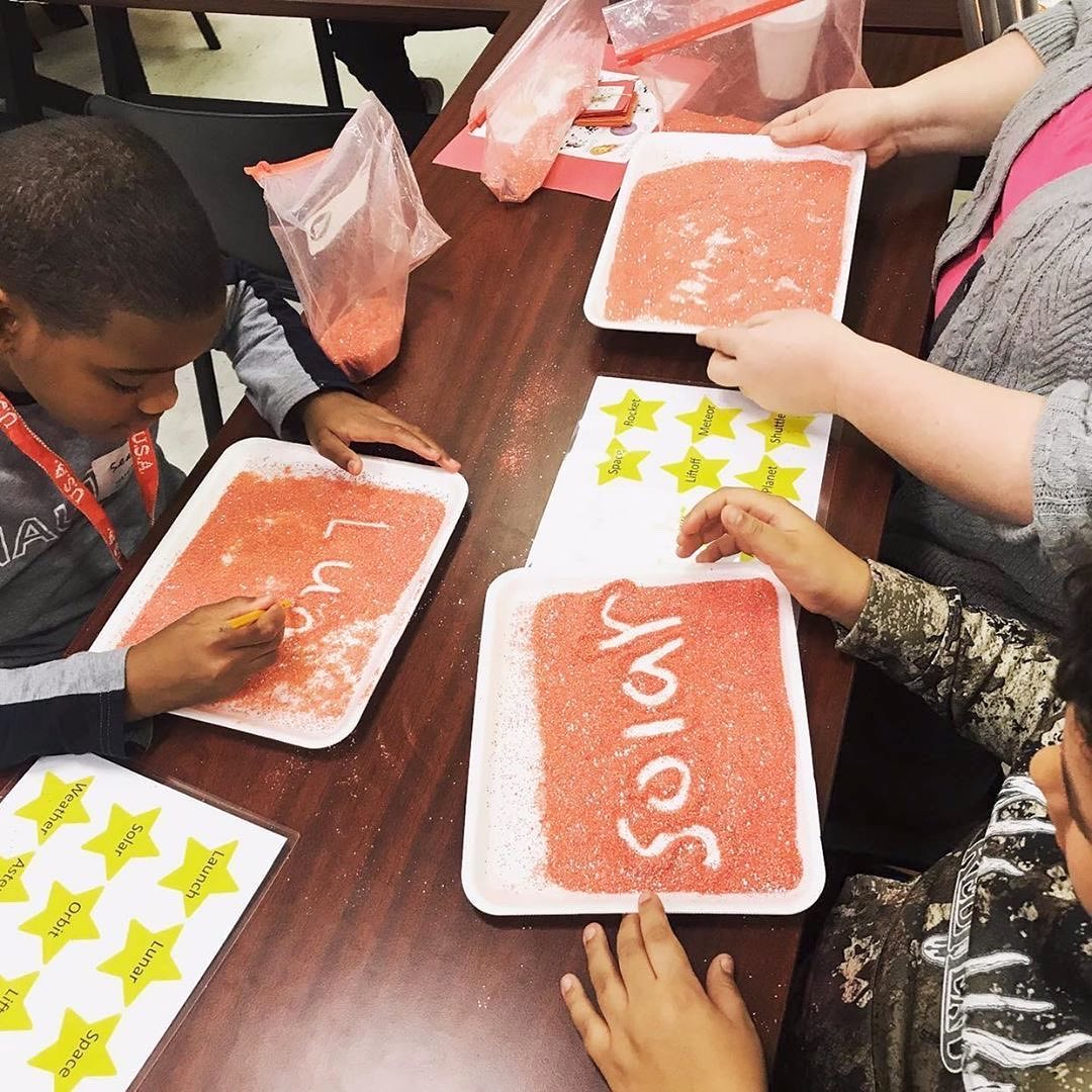 Students doing hands-on program.